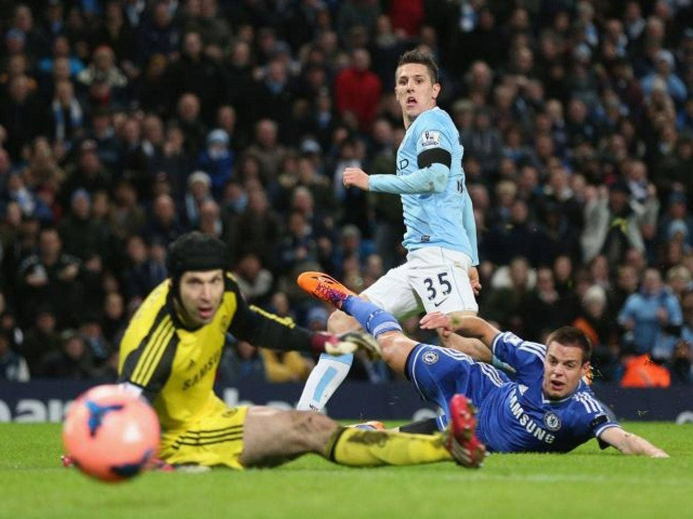 Watchmen: Stevan Jovetic looks on as he scores Manchester City's opening goal past Chelsea's Petr Cech (left) and Nemanja Matic (right) during yesterday's FA Cup tie