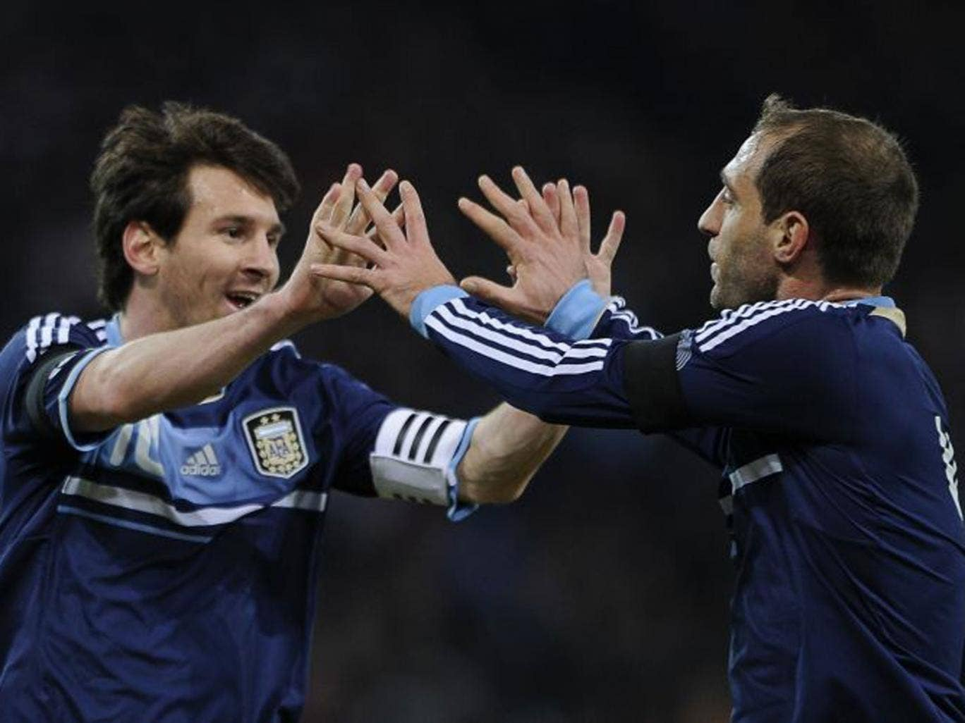 Hand it to him: Zabaleta (right) said he did not think Lionel Messi would be 'that' good until he saw him play for the Argentina U-20s