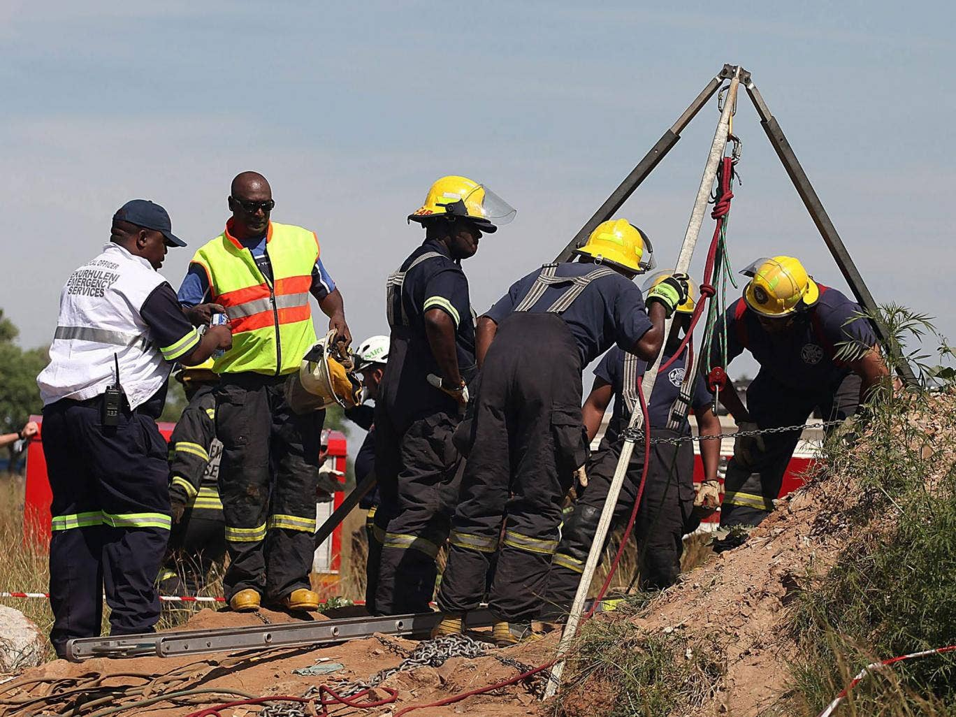 Rescue services and emergency personnel try to free miners trapped underground in Benoni, east of Johannesburg, South Africa, 16 February 2014