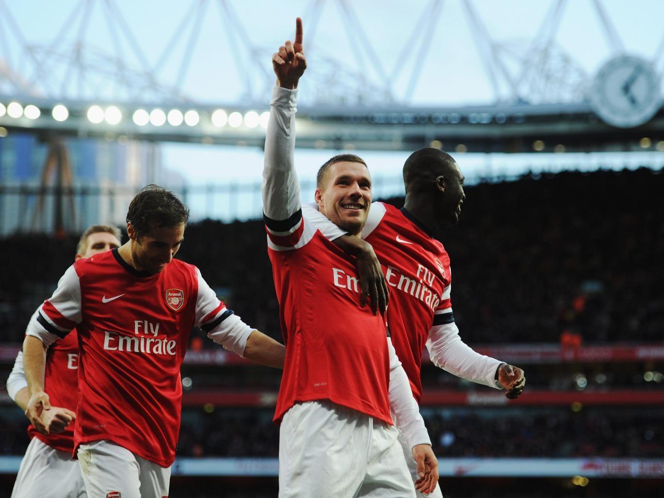 Luka Podolski celebrates after putting Arsenal 2-0 ahead against Liverpool