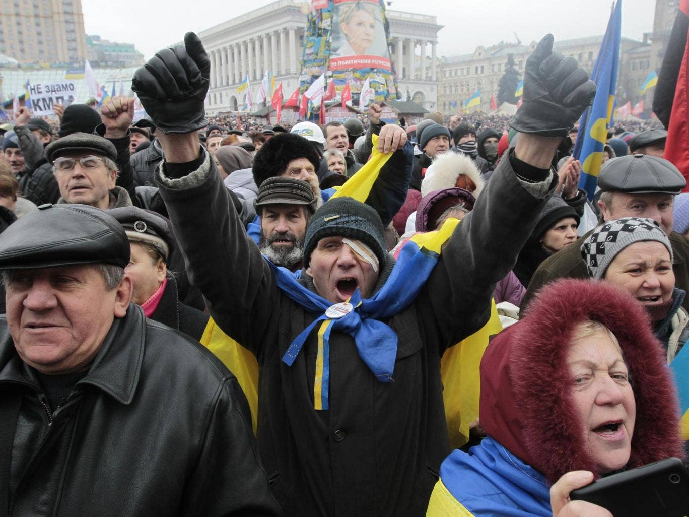 Opposition supporters shout slogans during a rally in Independence Square in Kiev, Ukraine