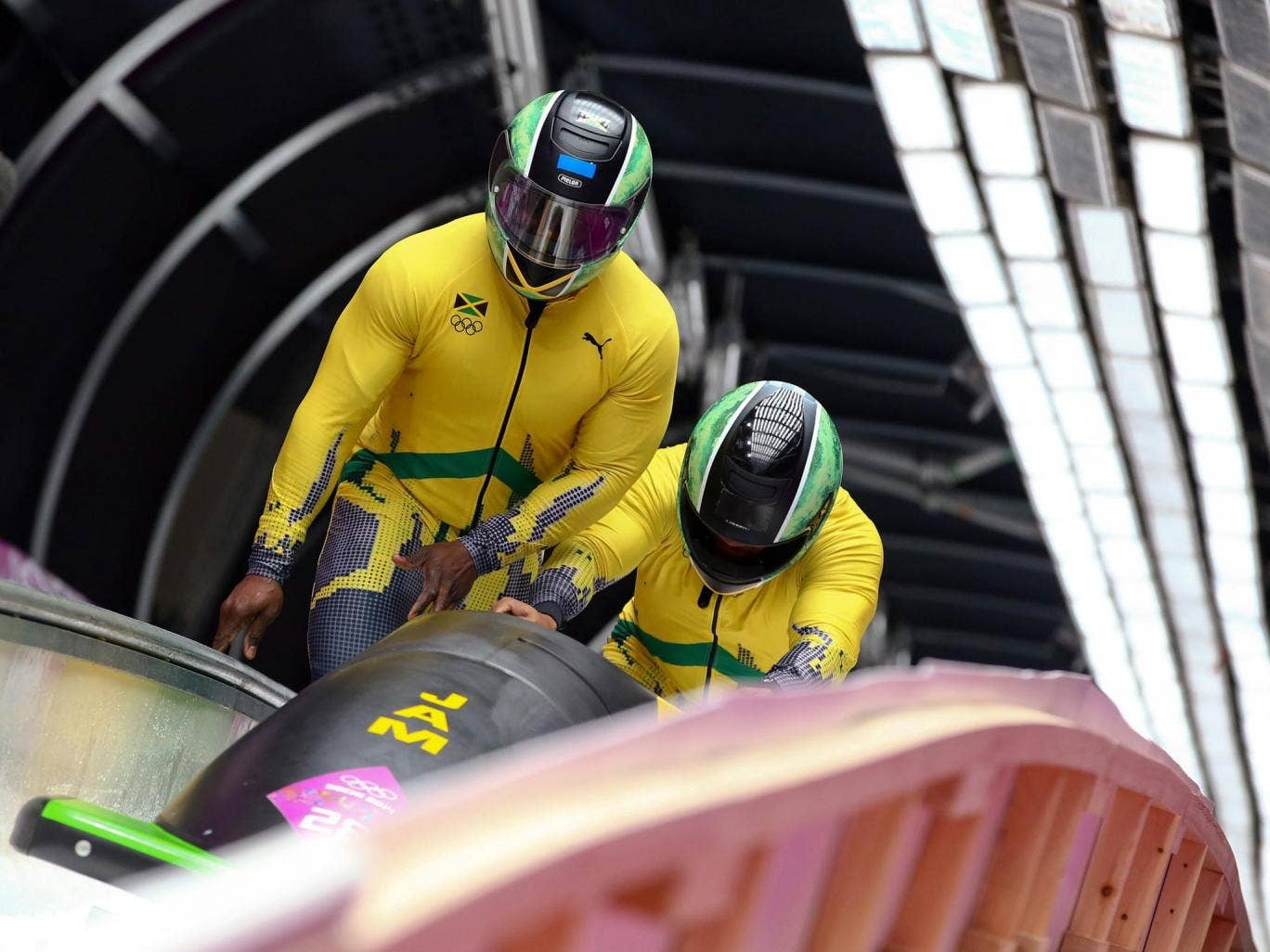 Winston Watts and Marvin Dixon of Jamaica after the second run of the Two-Man Bobsleigh competition at the Sanki Sliding Center