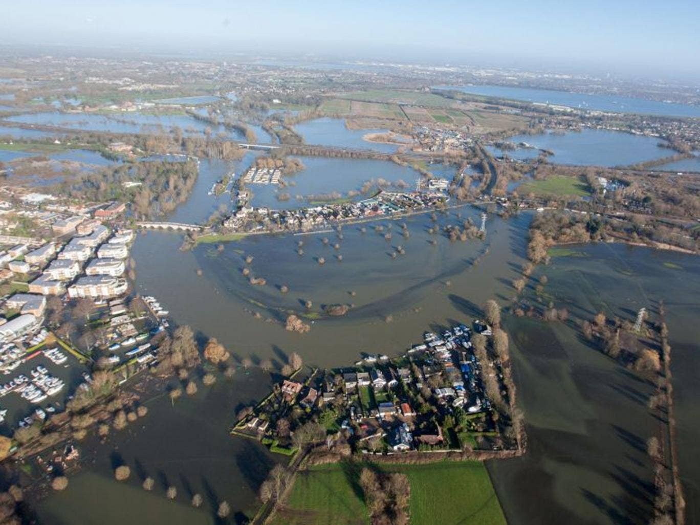 Flood water in Chertsey, Surrey, as Royal Engineers were now being tasked to carry out a high-speed assessment of damage to the UK's flood defence infrastructure