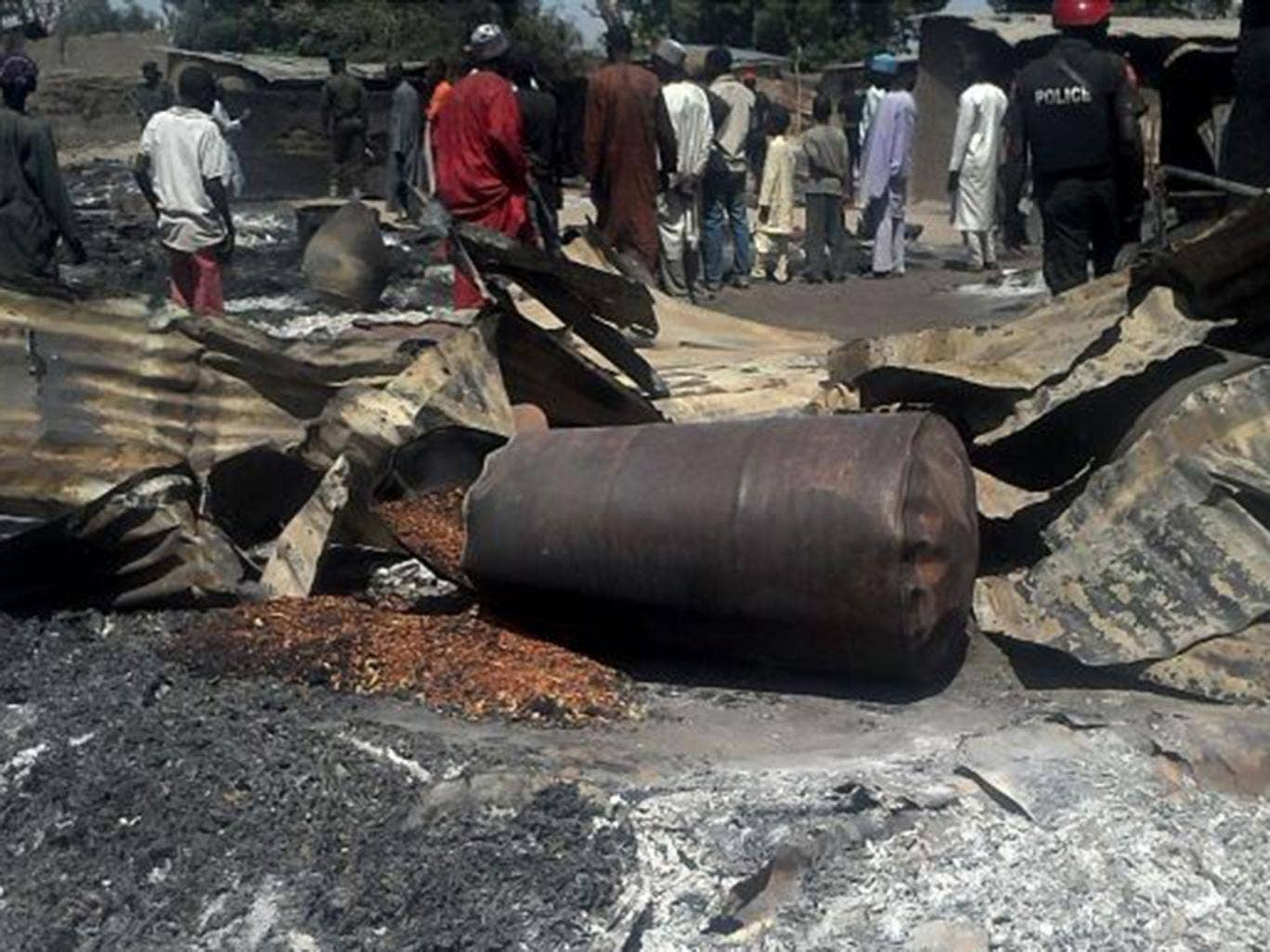 The aftermath of the earlier attack on Wednesday, when Boko Haram fighters in trucks painted in military colours killed 51 people in  Konduga