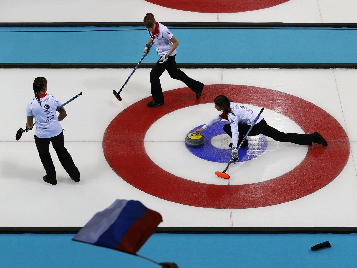 Great Britain skipper Eve Muirfield throws a stone across the ice during the 9-6 victory over Russia
