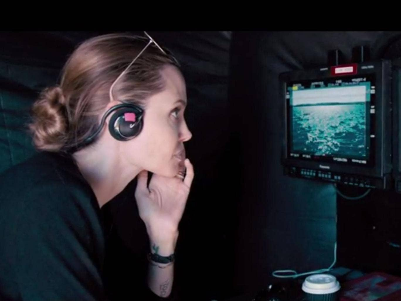 Angelina Jolie is seen in the director's chair in the first trailer for Unbroken