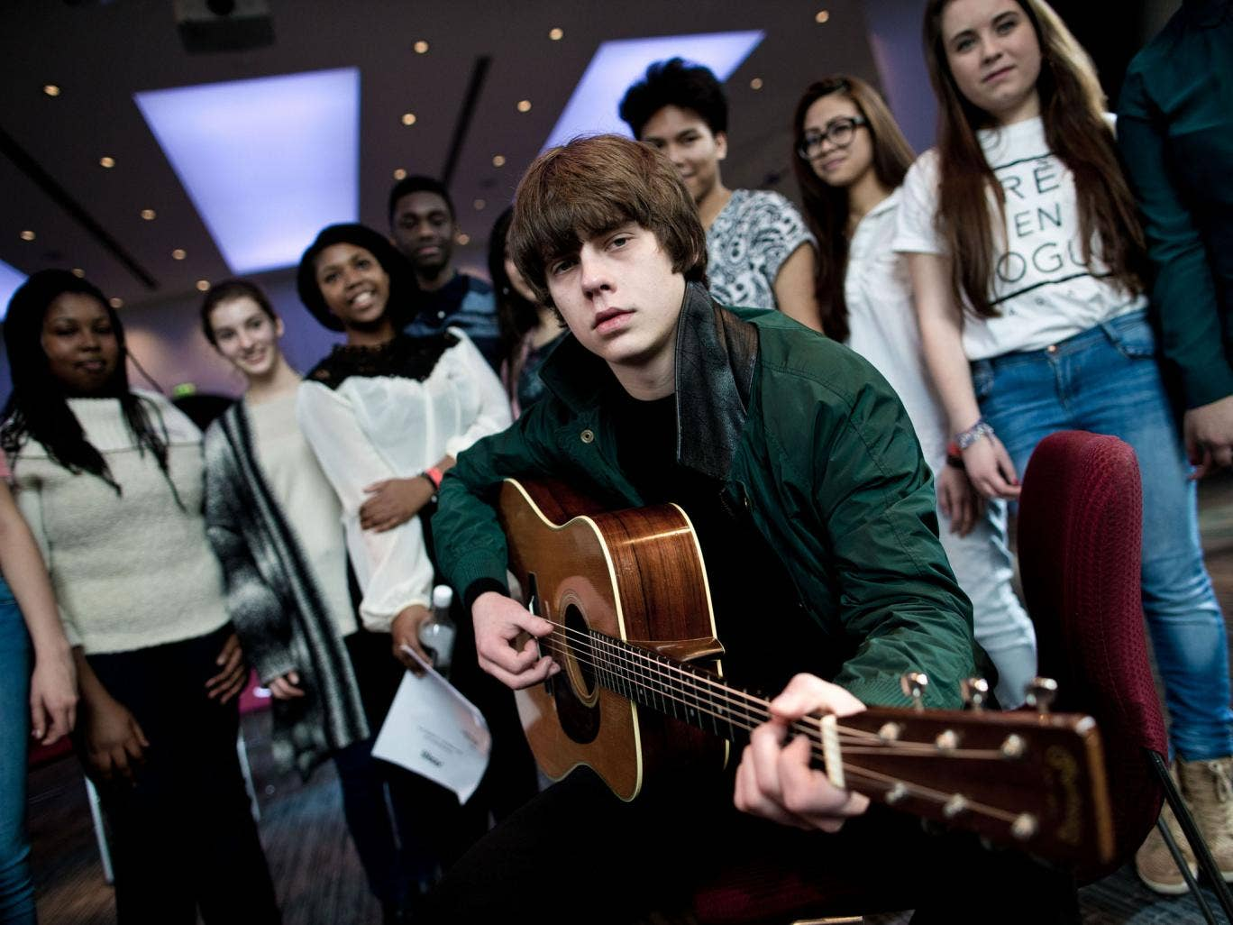 Singer-songwriter Jake Bugg photographed in the Elgar Room at the Royal Albert Hall with 10 young vocalists from schools in the Tri-Borough Music Hub