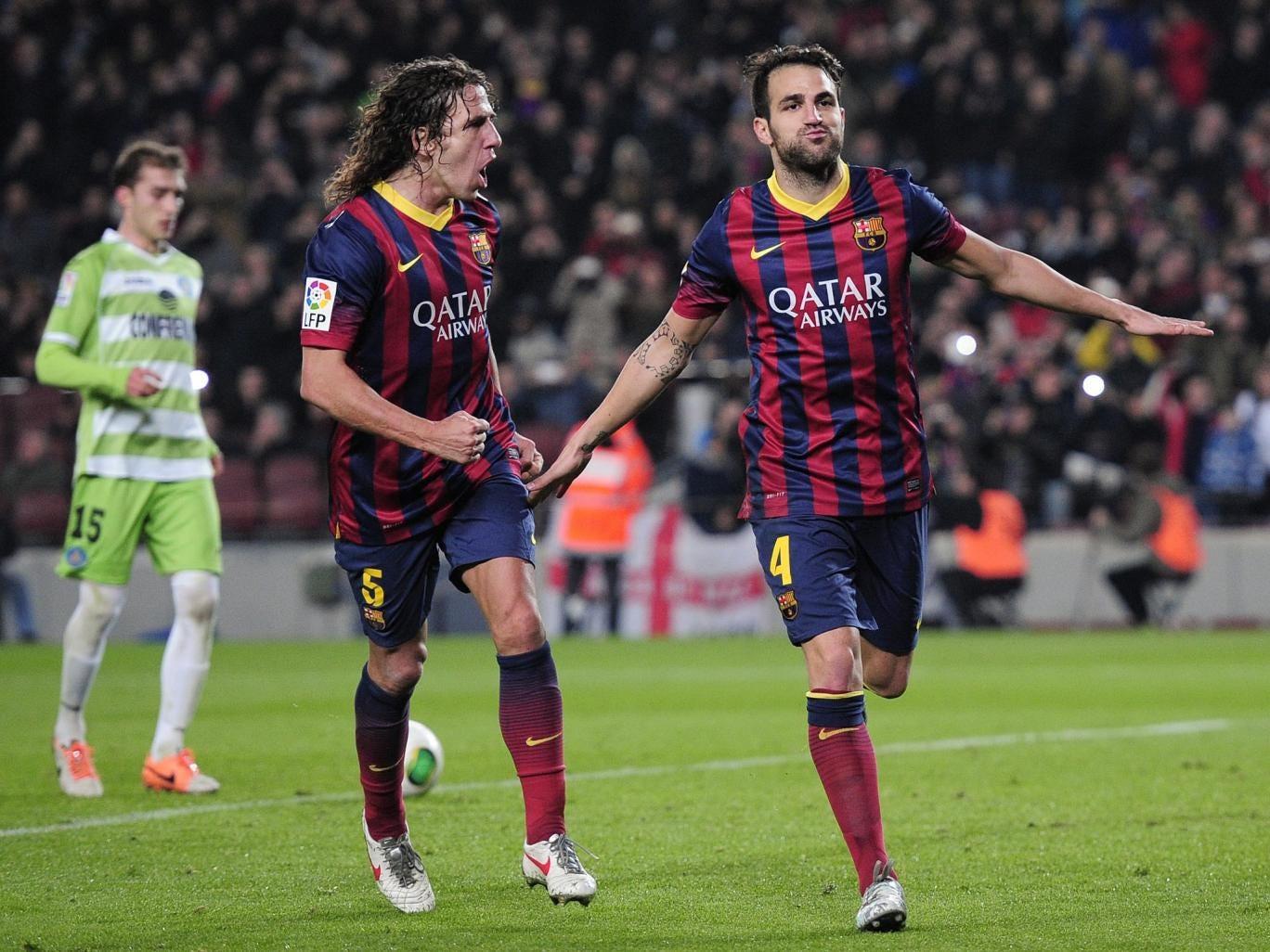 Cesc Fabregas (right) celebrates scoring against Getafe in the Copa del Rey last month