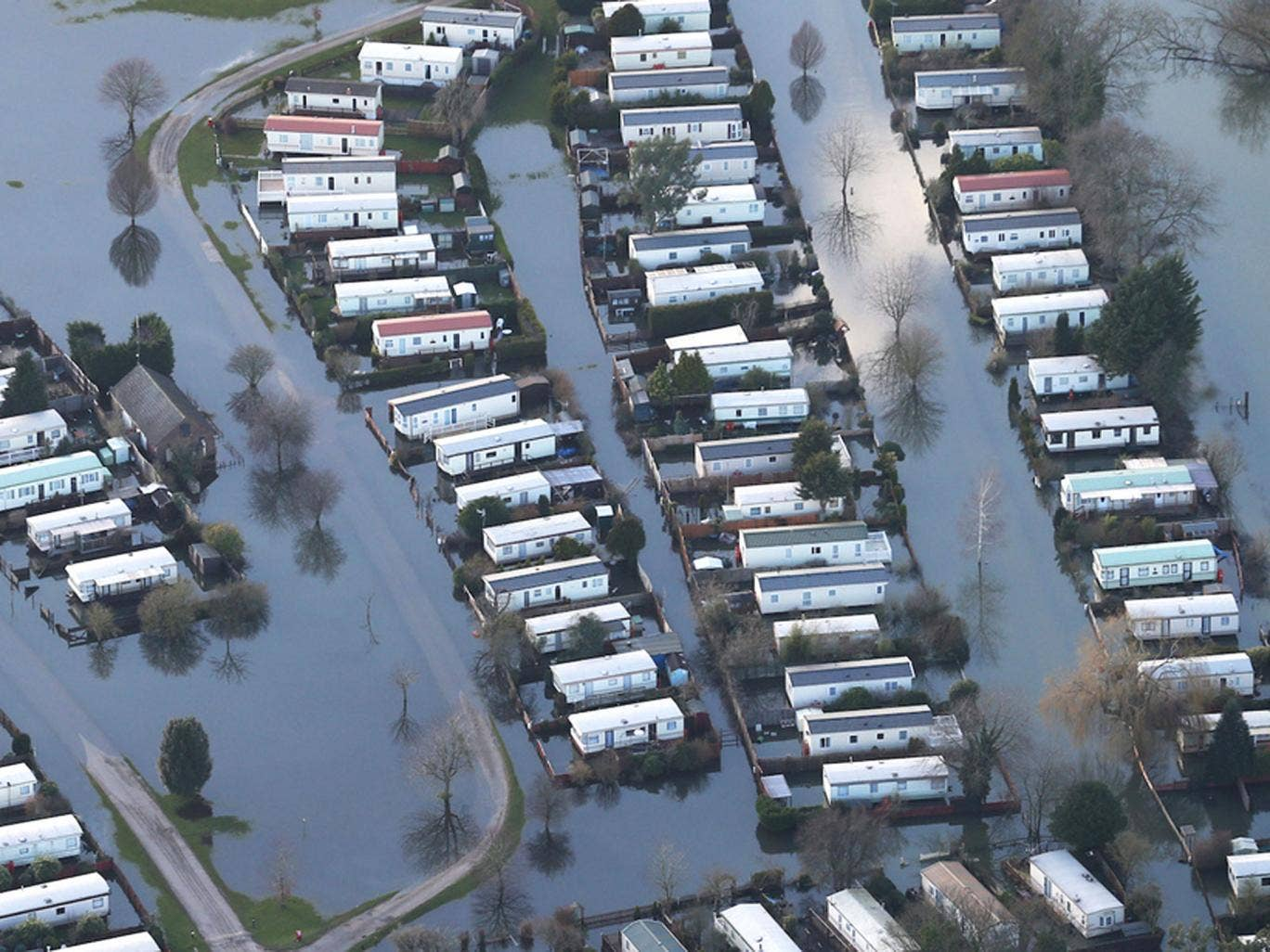 A caravan park is inundated with flood water in Hurley