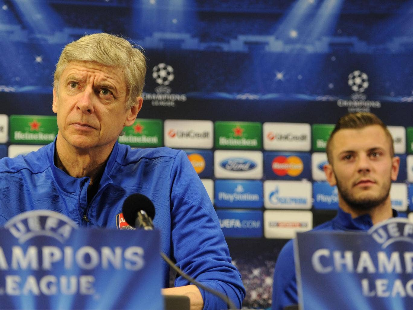 Arsene Wenger and Jack Wilshere talk to the press