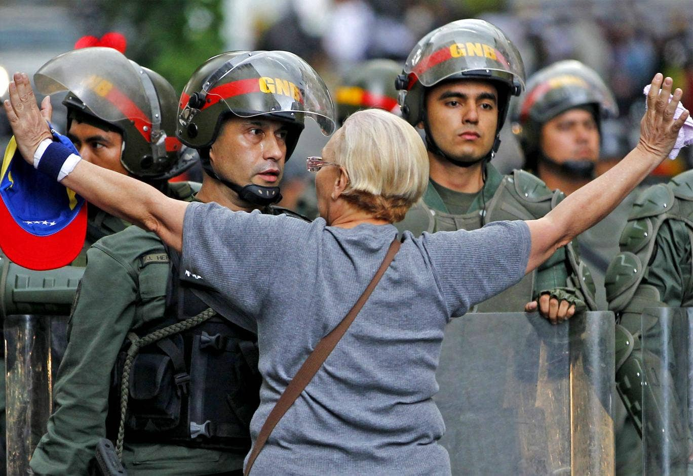 An opposition supporter shouts at a riot police officer during a protest against President Nicolas Maduro's government in Caracas