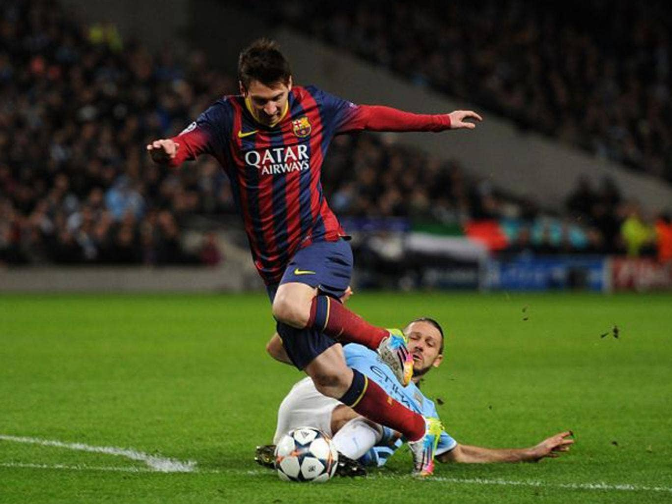 Manchester City's Martin Demichelis brings down Barcelona's Lionel Messi to concede a penalty and receives a red card