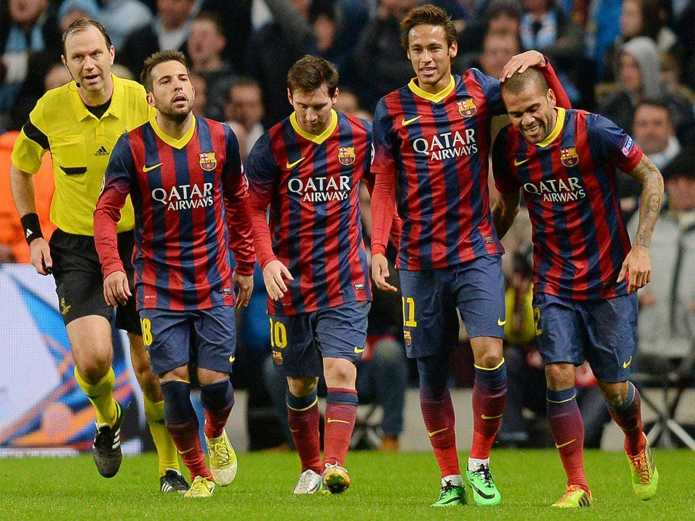 Barcelona players celebrate Dani Alves' goal - which may have put the tie beyond Manchester City