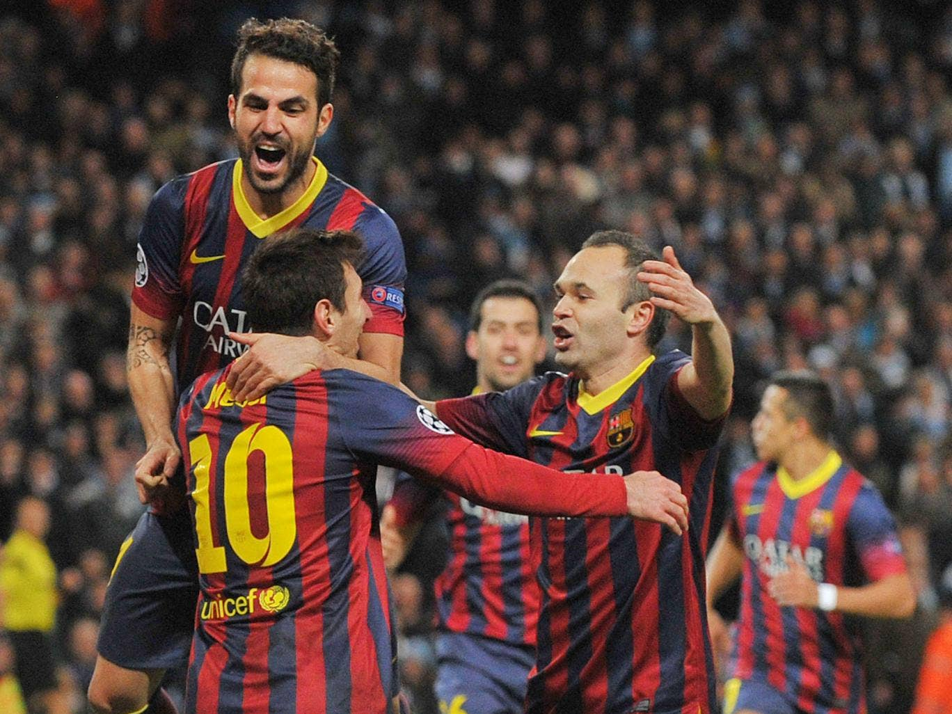 Cesc Fabregas and Andres Iniesta celebrate with Lionel Messi in their 2-0 win over Manchester City