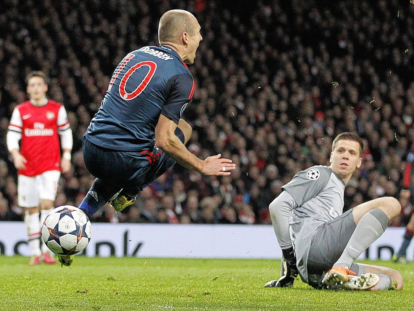 Arjen Robben is brought down by Wojciech Szczesny during Bayern Munich's 2-0 victory over Arsenal