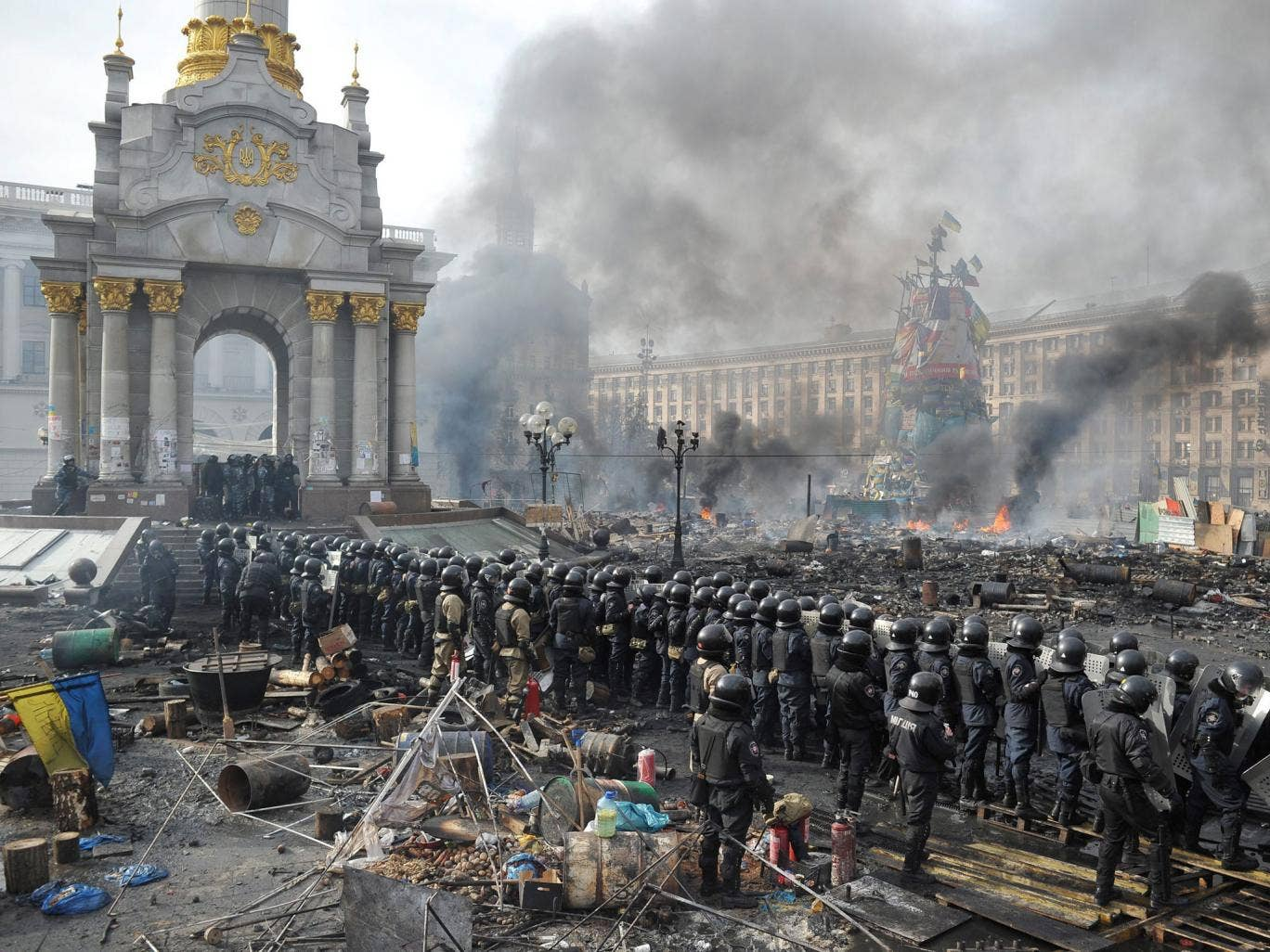 Riot police line up against anti-government protesters in Independence Square in central Kiev. More than 600 police and protesters have been injured