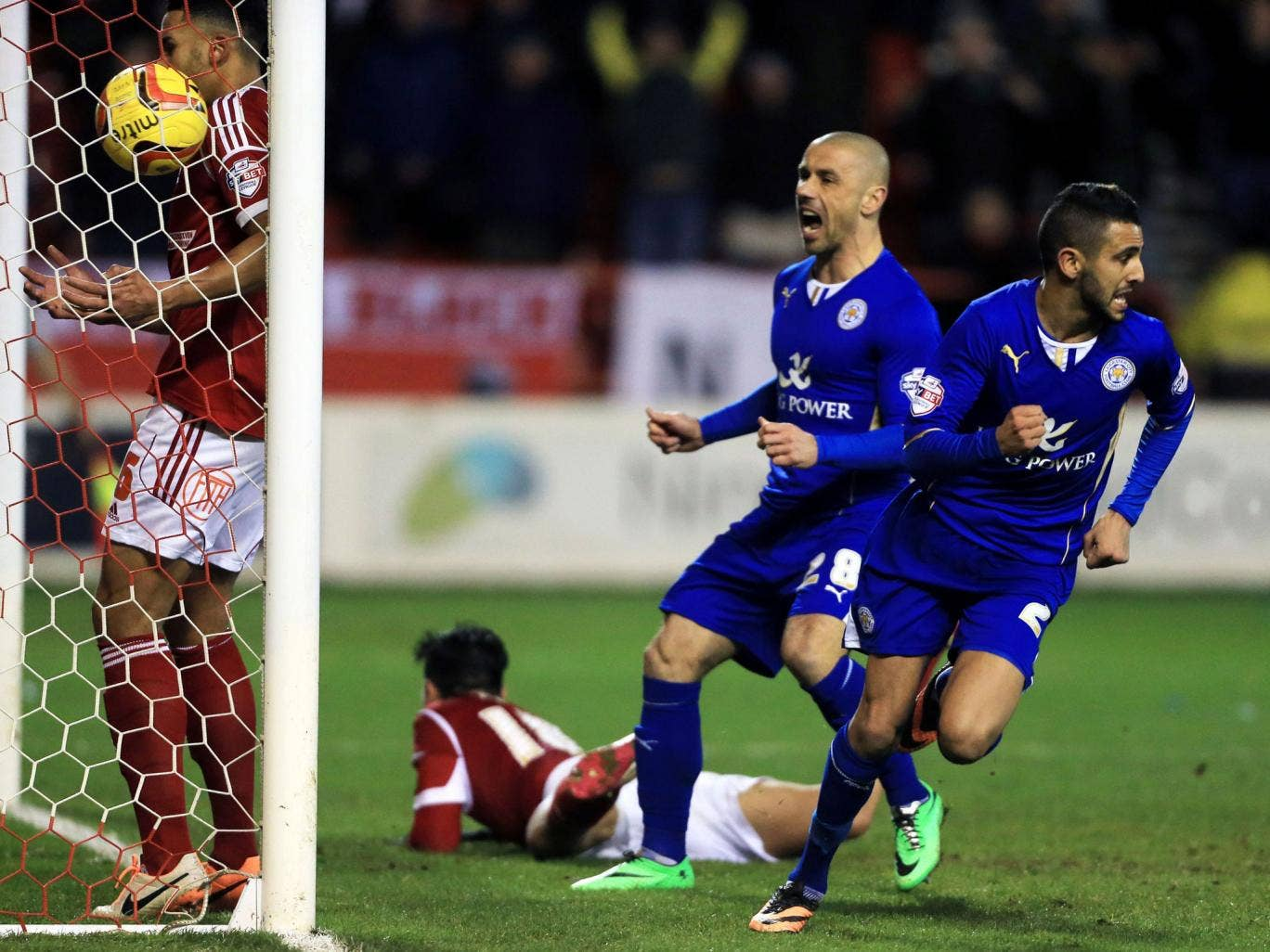 Leicester City's Riyad Mahrez, right, celebrates scoring the equaliser goal on the rebound from Kevin Phillips missed penalty during 2.2 draw against Nottingham Forest