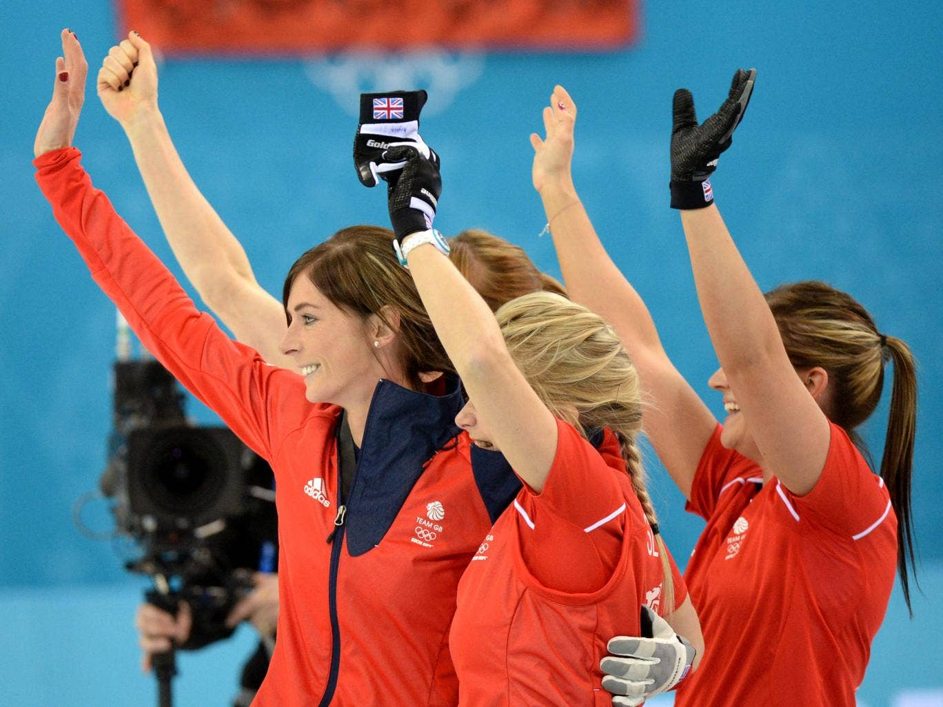 Great Britain's Anna Sloan, Eve Muirhead, Vicki Adams and Claire Hamilton celebrate after winning the Women's Curling Bronze Medal Game at the Ice Cube Curling Center