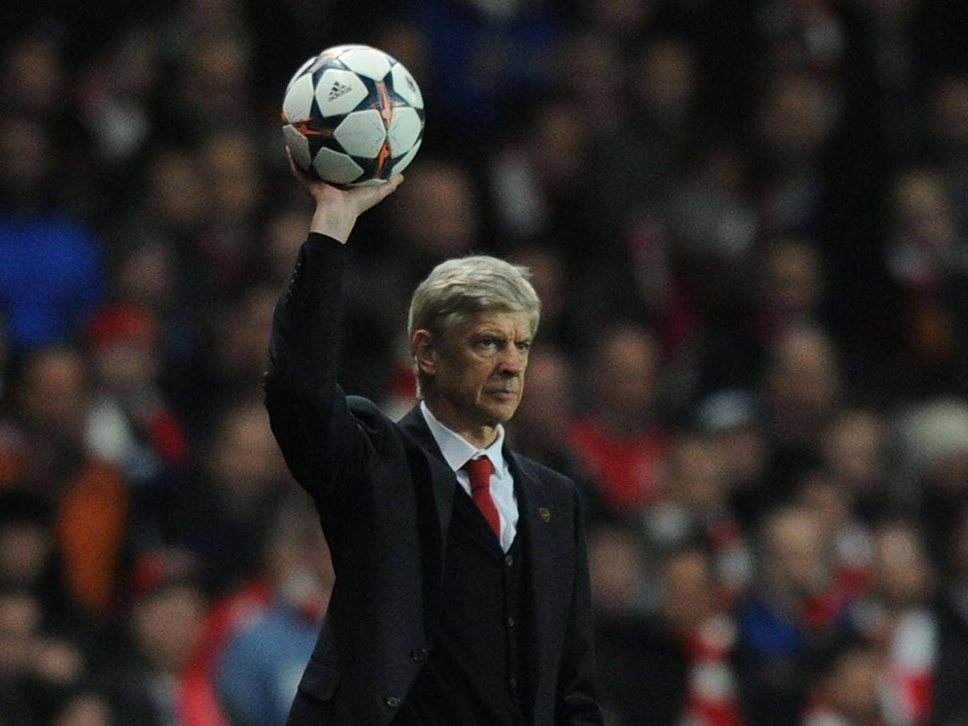 Arsene Wenger throws the ball back into play during Arsenal's 2-0 defeat against Bayern Munich on Wednesday night