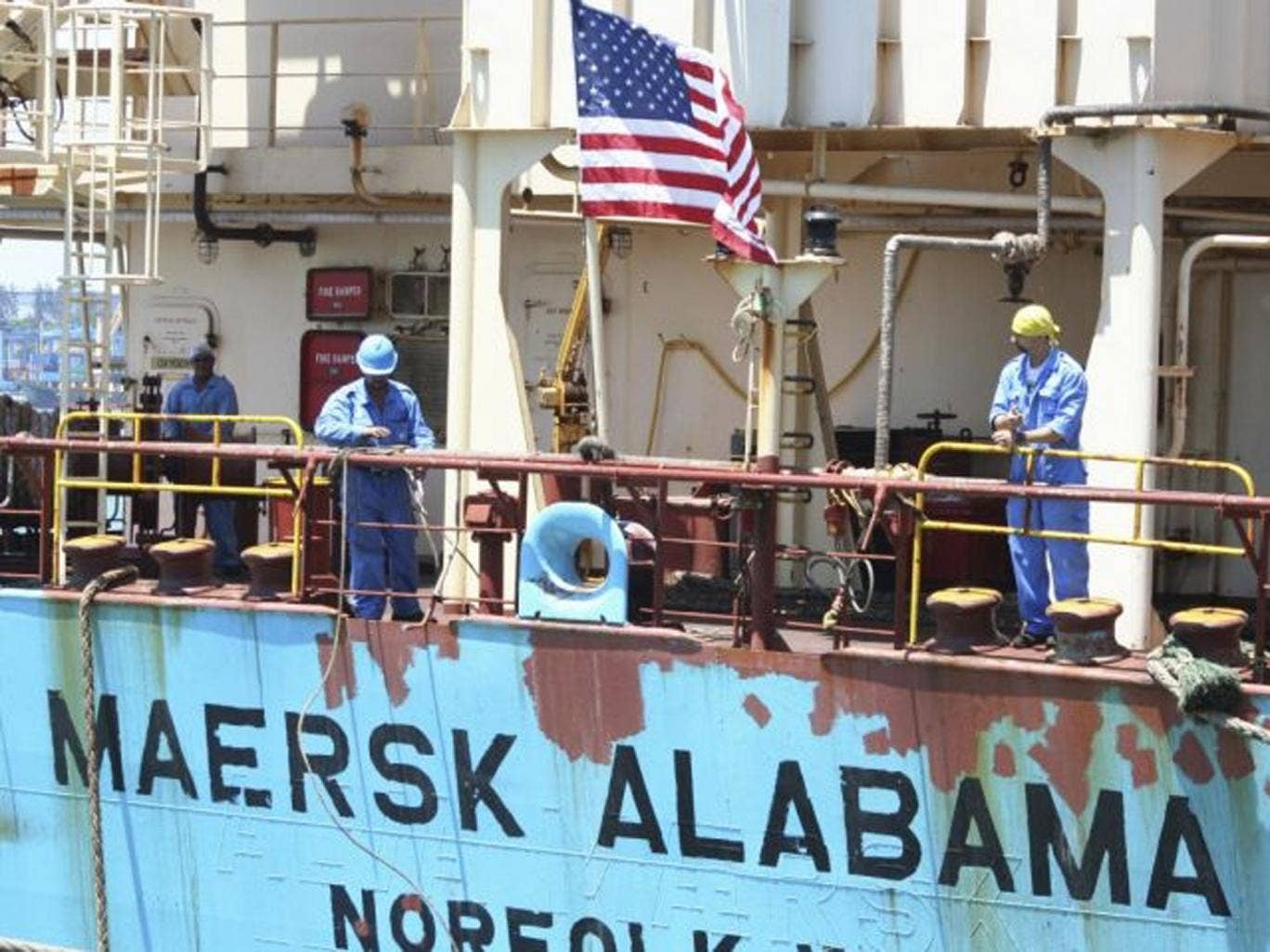FILE - In this Nov. 22, 2009 file photo, crew members work aboard the U.S.-flagged Maersk Alabama after the ship docked in the harbour of Mombasa, in Kenya. Police in the Indian Ocean island nation of Seychelles said Wednesday, Feb. 19, 2014 that two Amer