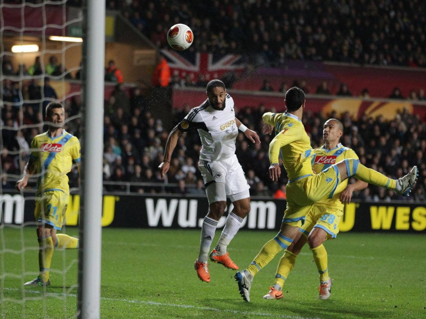 Swansea City's Ashley Williams header is saved by Napoli goalkeeper Pepe Reina (out of shot) during the UEFA Europa League