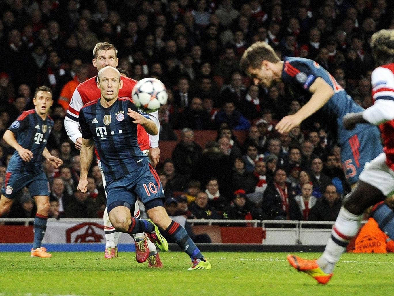 Thomas Müller scores Bayern Munich's second goal to leave Arsenal on the brink of elimination