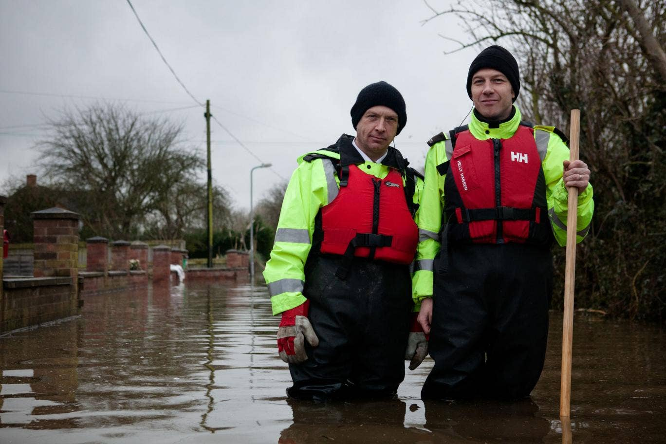 Members of the Avon and Somerset Police visit people still living in their flooded homes