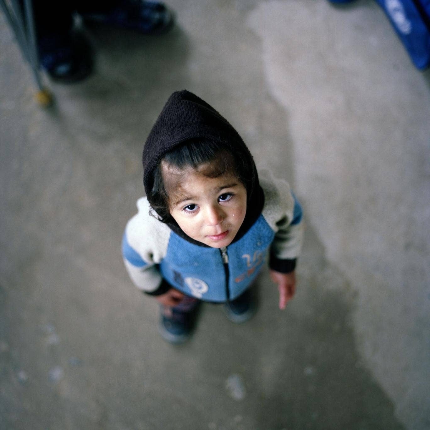 This little girl's family managed to escape Homs and found sanctuary in a mosque in Chhim