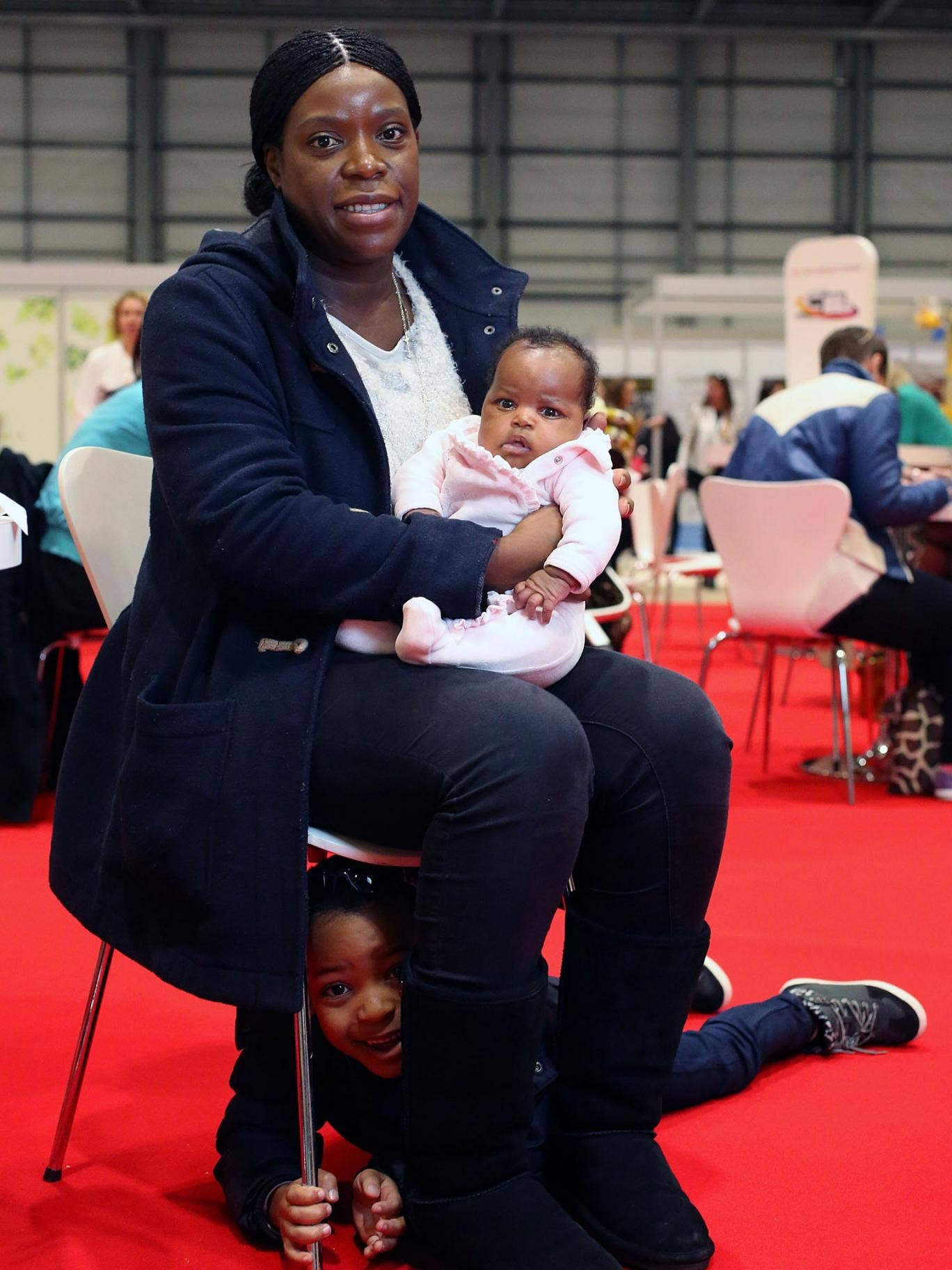 Jeanne Badinge, 30, with her children Thierry, four, and Celine, one month, at the work and parenting show