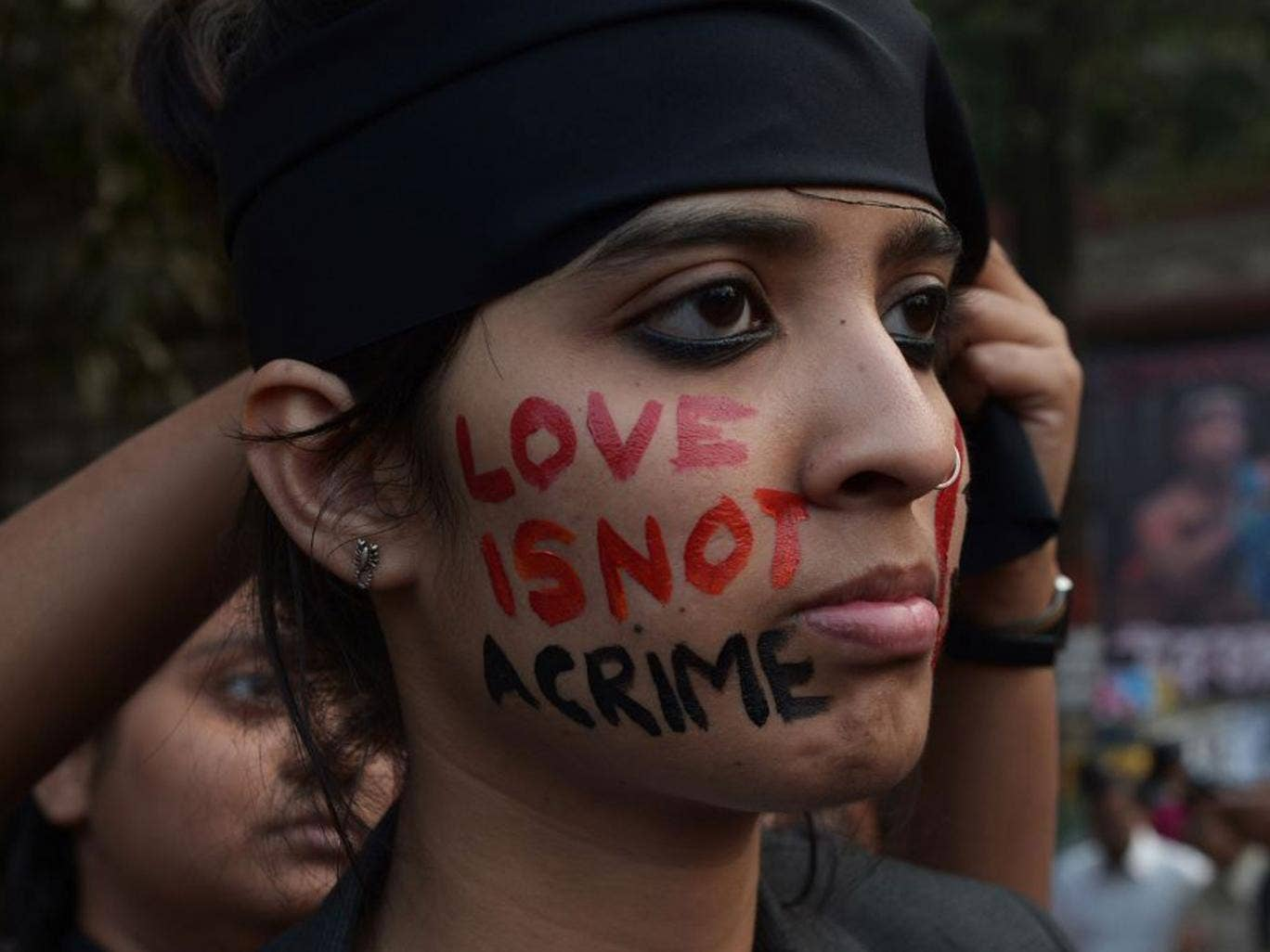 An activist during protests in Kolkata late last year, when the Supreme Court first decided to reinstate a 19th-century law criminalising homosexuality