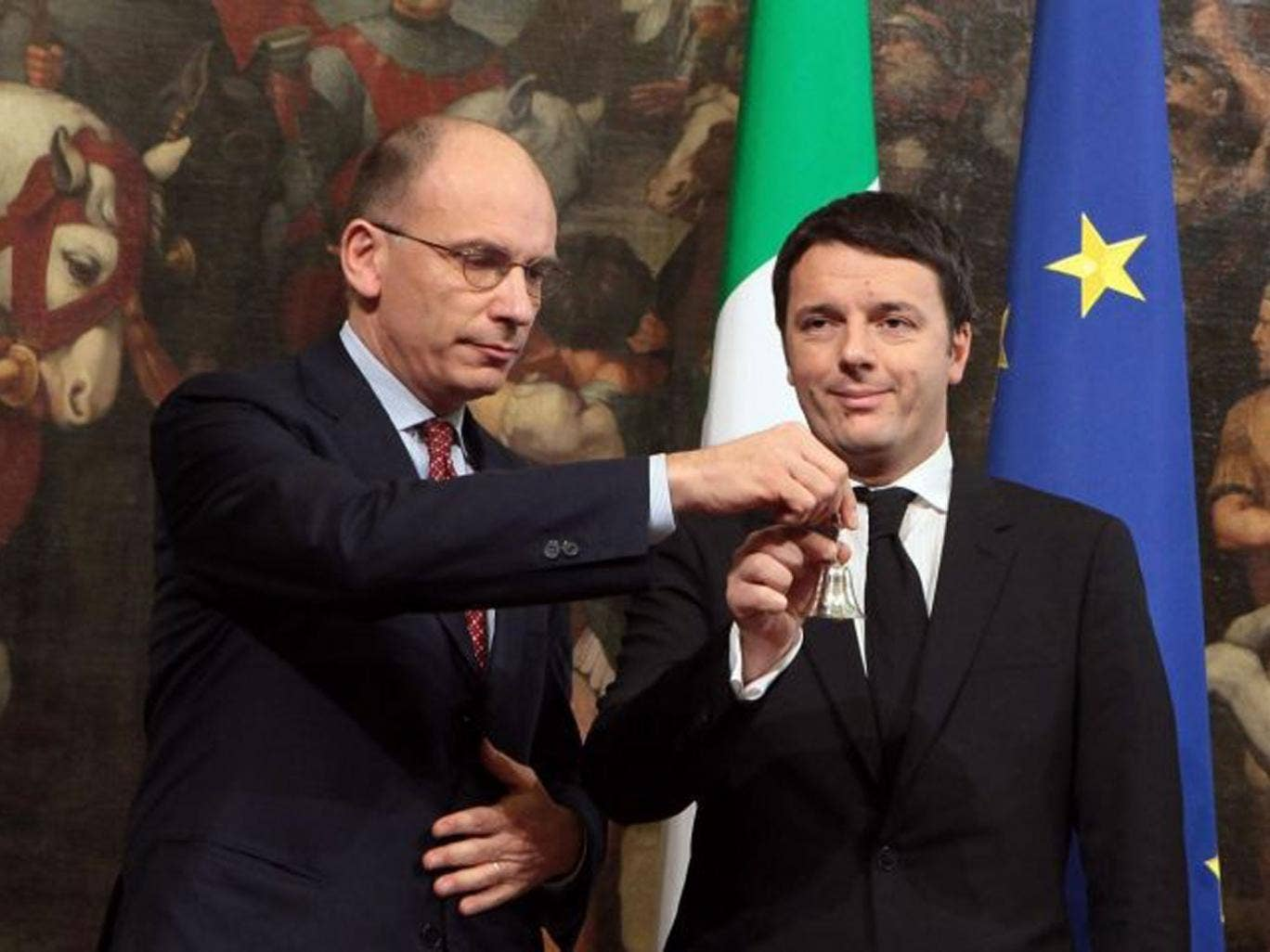 Matteo Renzi (right), with outgoing PM Enrico Letta, at the handover ceremony in Rome yesterday