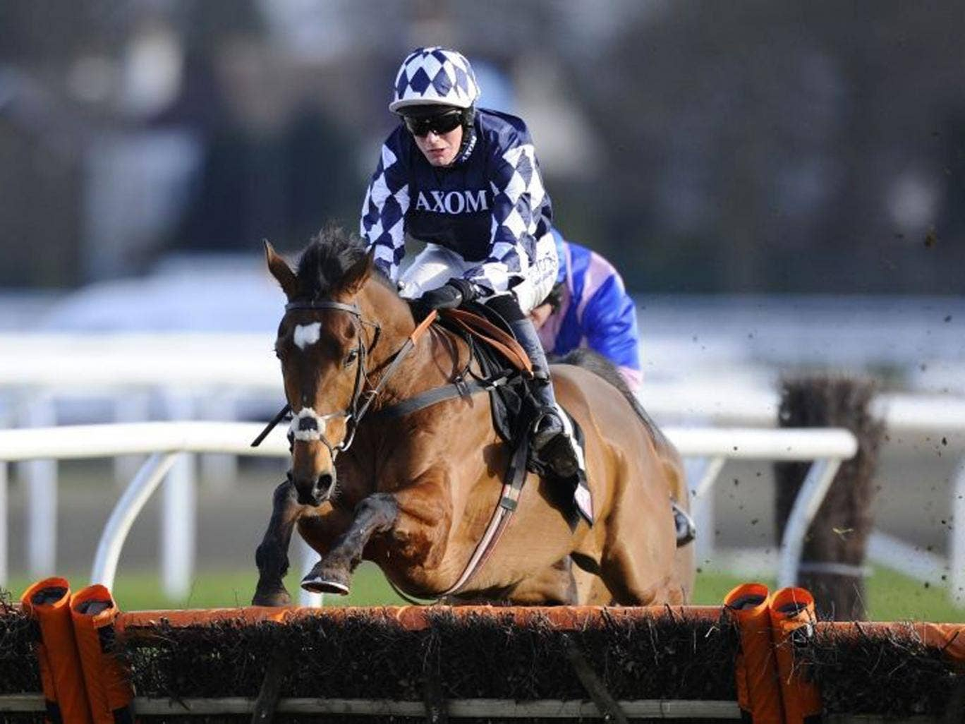 Blazing away: Irving pulls clear to win the Novices' Hurdle at Kempton by five lengths