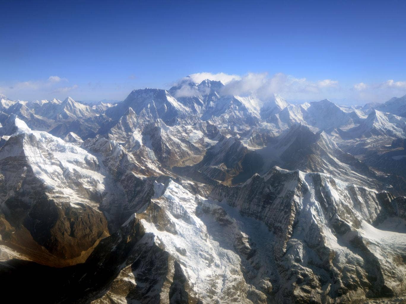 This photograph taken from an aircraft shows an aerial view of Mount Everest (C) and The Himalayan mountain range, some 140kms (87 miles) north-east of Kathmandu on April 3, 2013, on the 80th anniversary of the first manned flight over Mount Everest, the