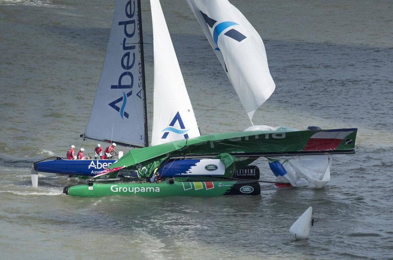 Serious crash but no serious injuries as Aberdeen Asset Management carves into potential French America's Cup contender Franck Cammas'  Groupama in the opening 2014 Extreme Sailing Series regatta in Singapore