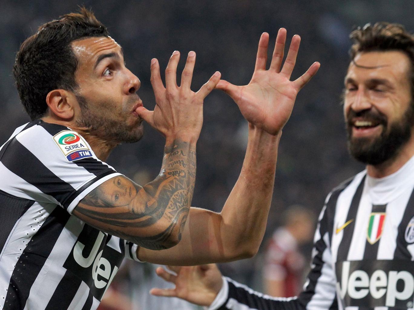 Juventus' Argentine forward Carlos Tevez celebrates after scoring during the Italian Serie A football match between Juventus and Torino at Juventus Stadium in Turin