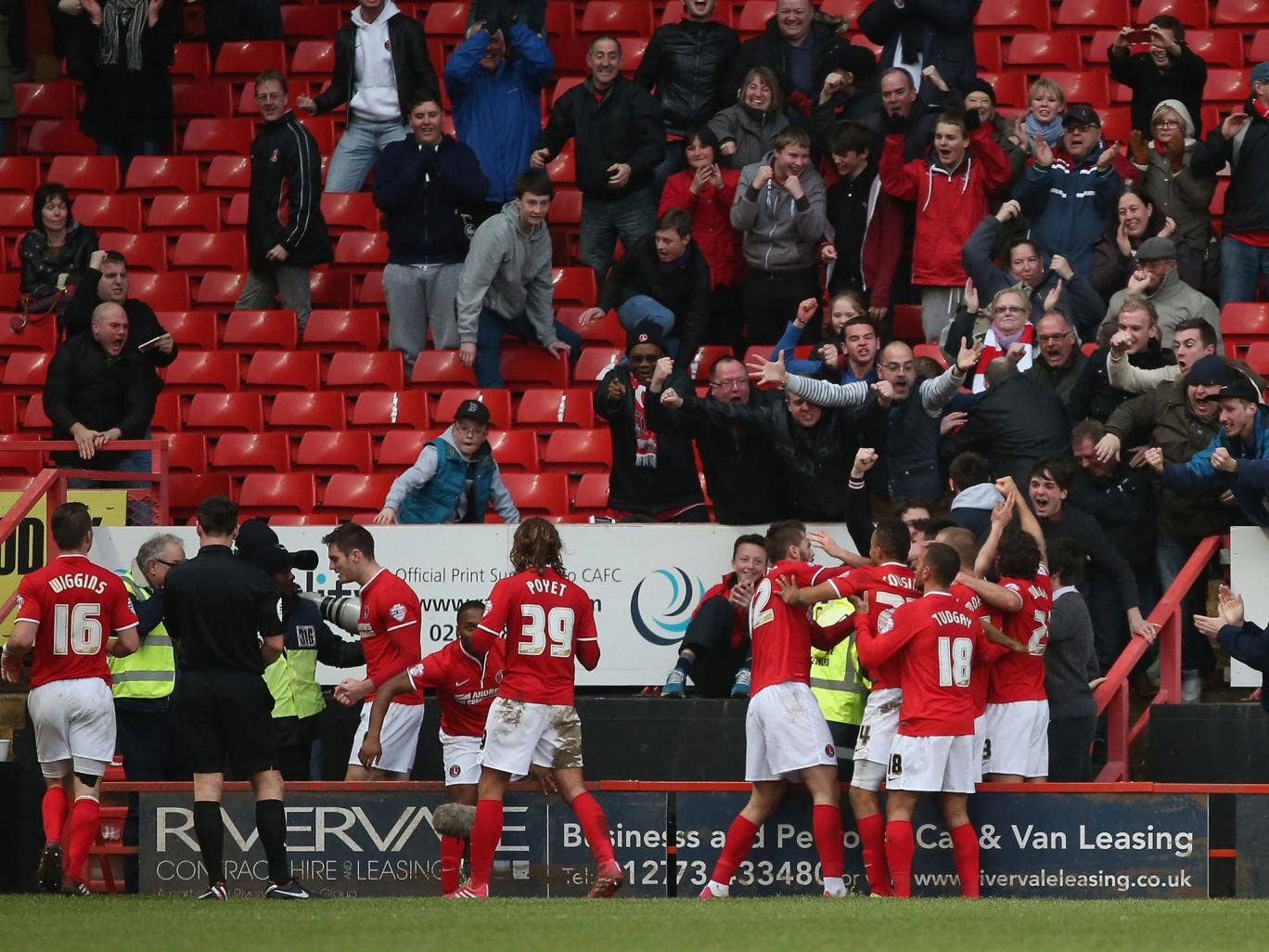 Charlton fans celebrate Johnnie Jackson's goal in the Championship clash with QPR