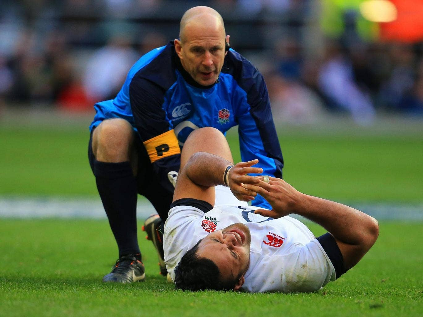 Billy Vunipola receives treatment on his injured ankle at Twickenham on Saturday