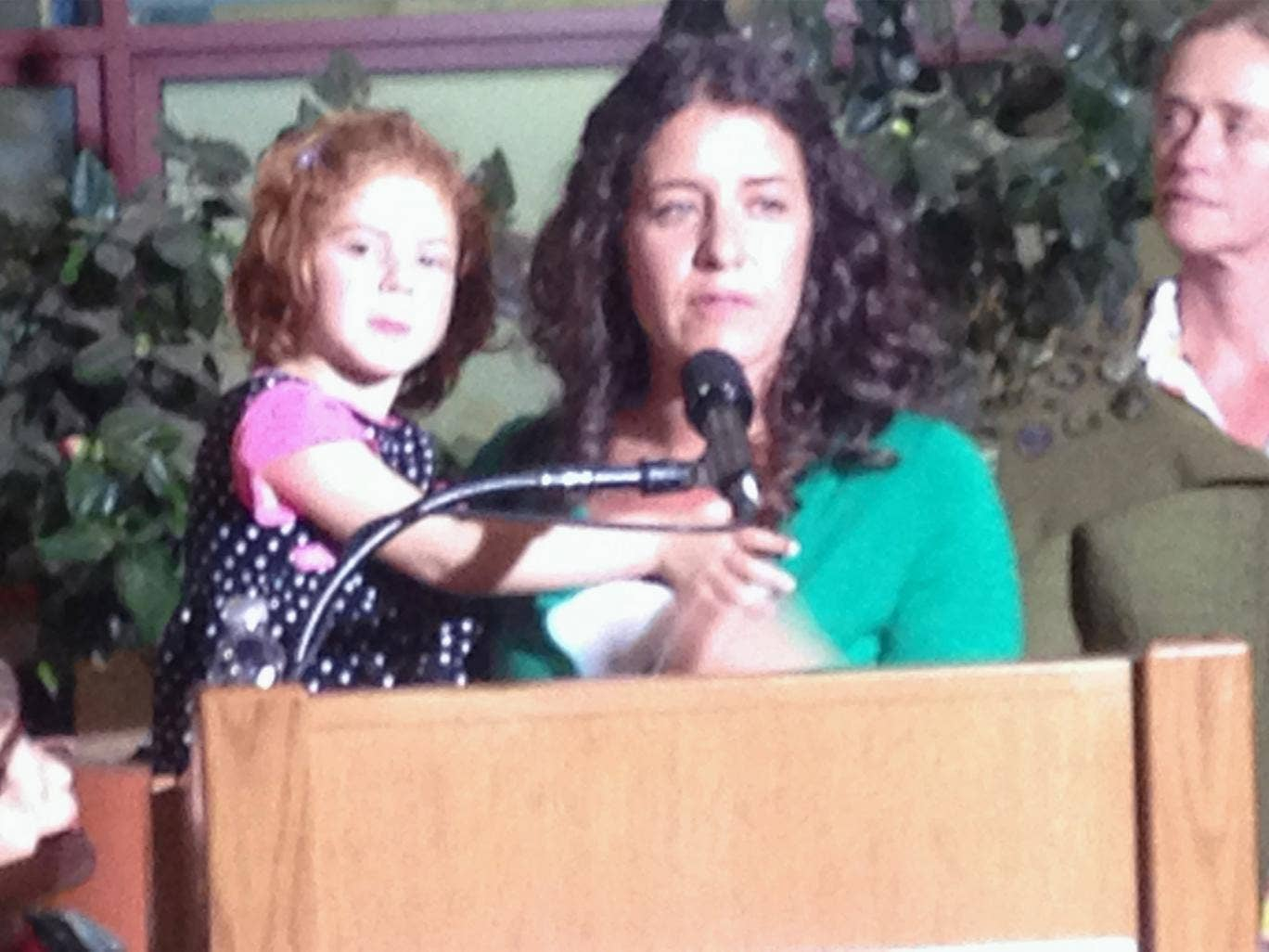 Jessica Tomei holds her 4-year-old daughter, Sofia Jarvis, during a news conference at Lucille Packard Children's Hospital at Stanford University