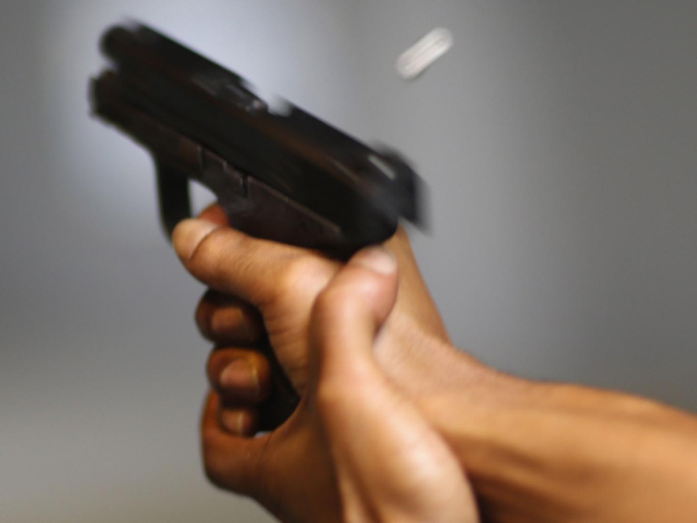POMPANO BEACH, FL - APRIL 11: As the U.S. Senate takes up gun legislation in Washington, DC , a handgun is used on the indoor firing range at the National Armory gun store on April 11, 2013 in Pompano Beach, Florida. The Senate voted 68-31 to begin debate