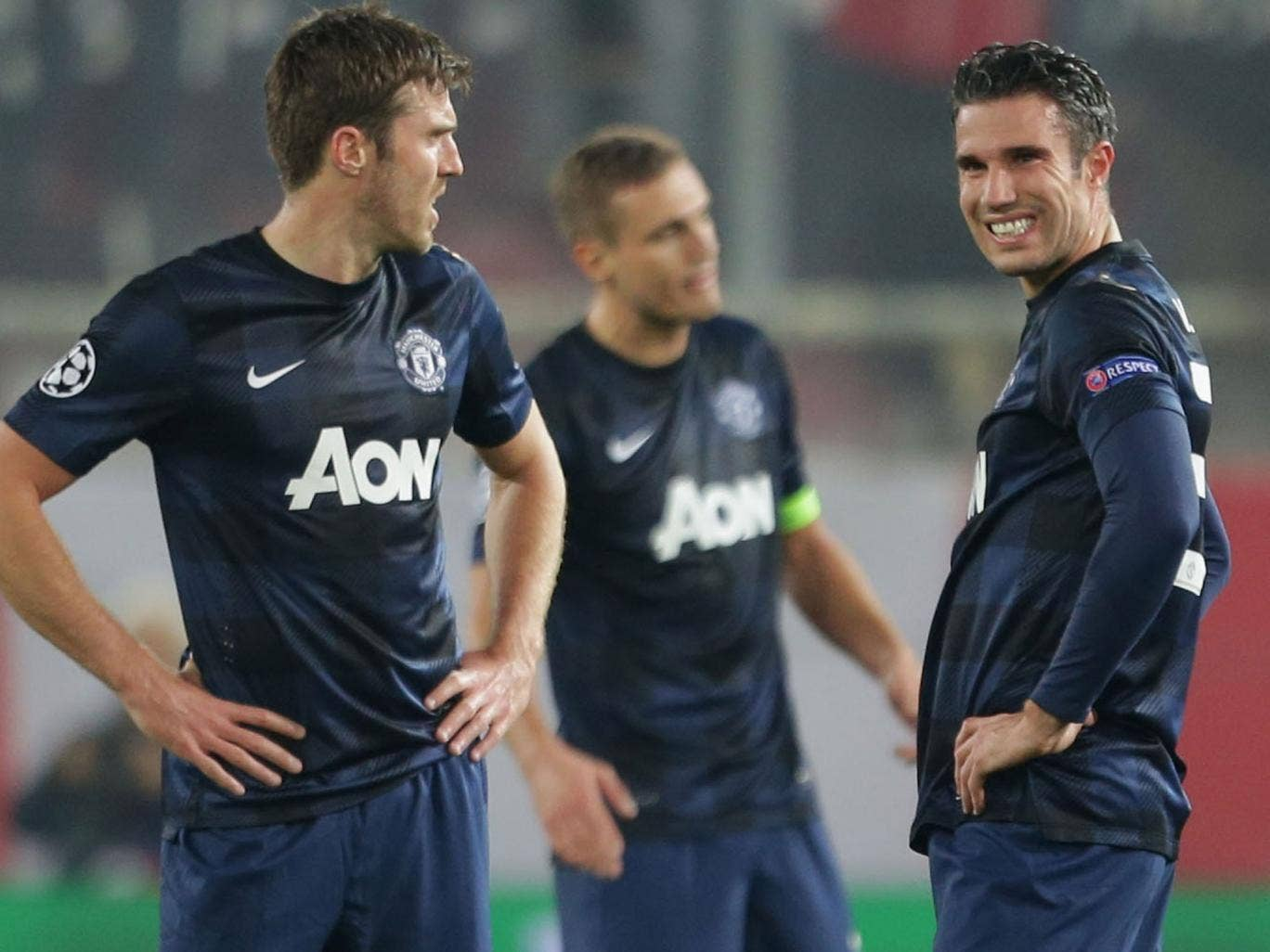 Michael Carrick (left), Nemanja Vidic (centre), and Robin van Persie (right) look on in despair during Manchester United's 2-0 defeat at Olympiakos