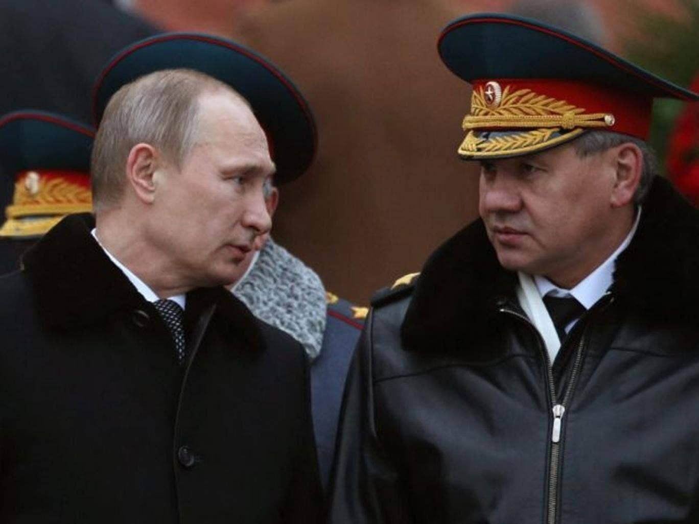 Defence Minister Sergei Shoigu (right) announced President Putin's order in a televised statement