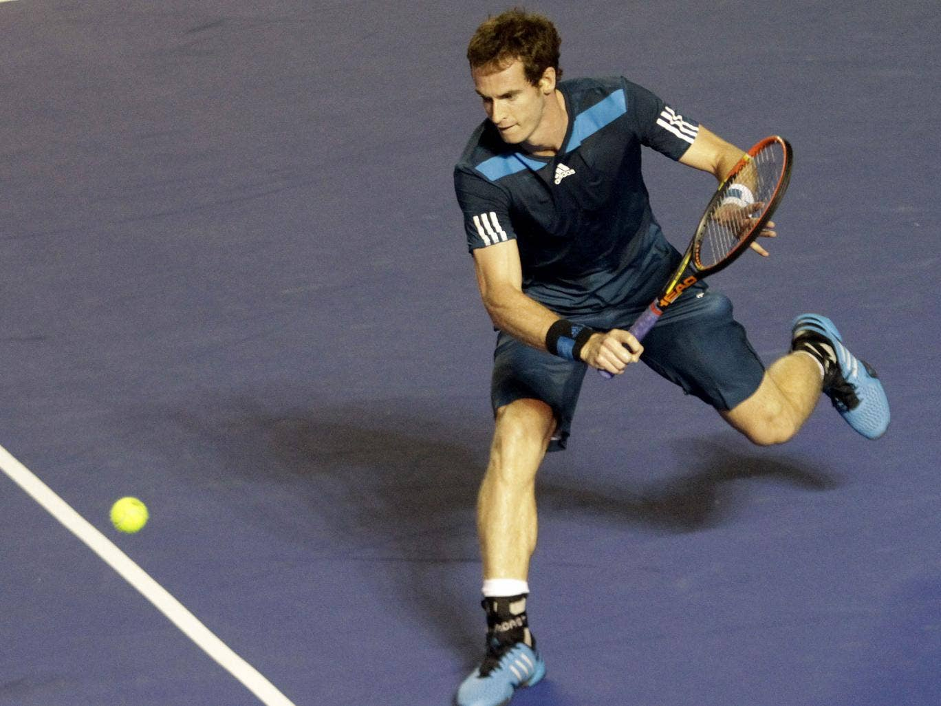 Andy Murray plays a backhand during his victory at the Mexico Open