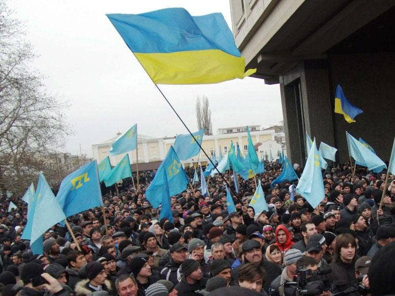 Pro-Ukrainian activists rally in front of the Crimean parliament in Semfiropol yesterday