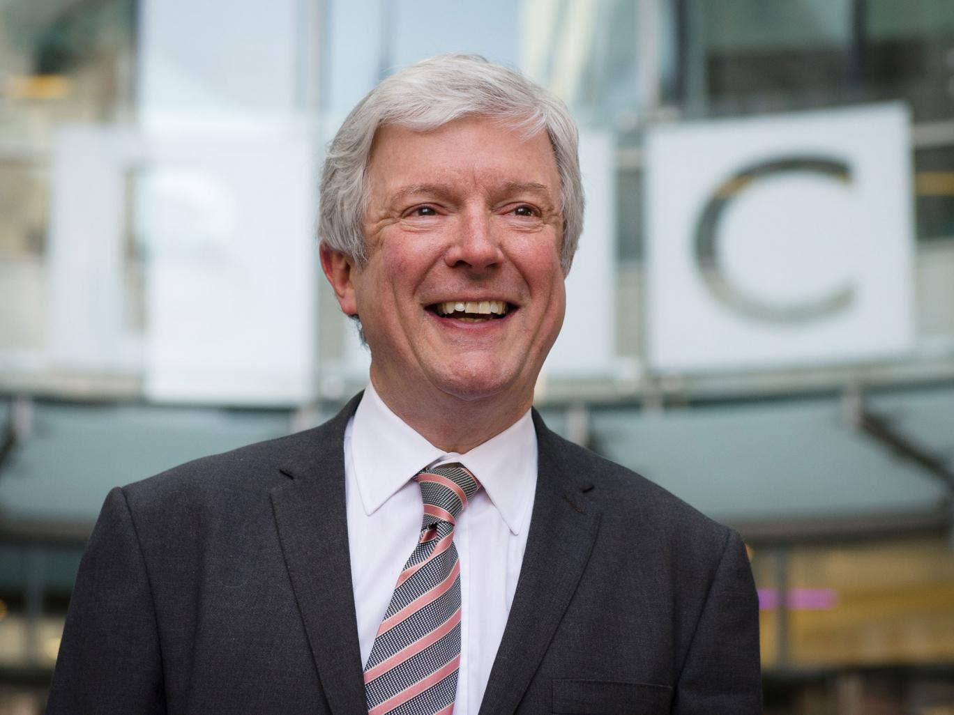 Tony Hall smiles as he arrives for his first day as Director General of the BBC at New Broadcasting House in central London on April 2, 2013. Having previously worked as Chief Executive at the Royal Opera House, the new BBC chief must now deal with the fa