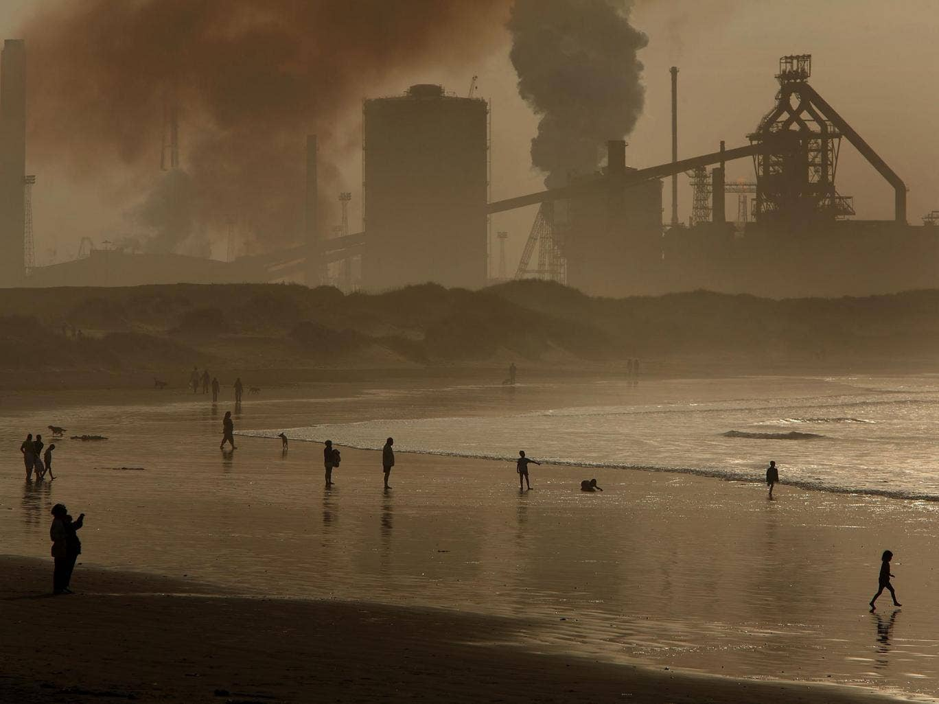 Pea soupers: locals on Redcar beach in the shadow of the Corus Steelworks in Teesside