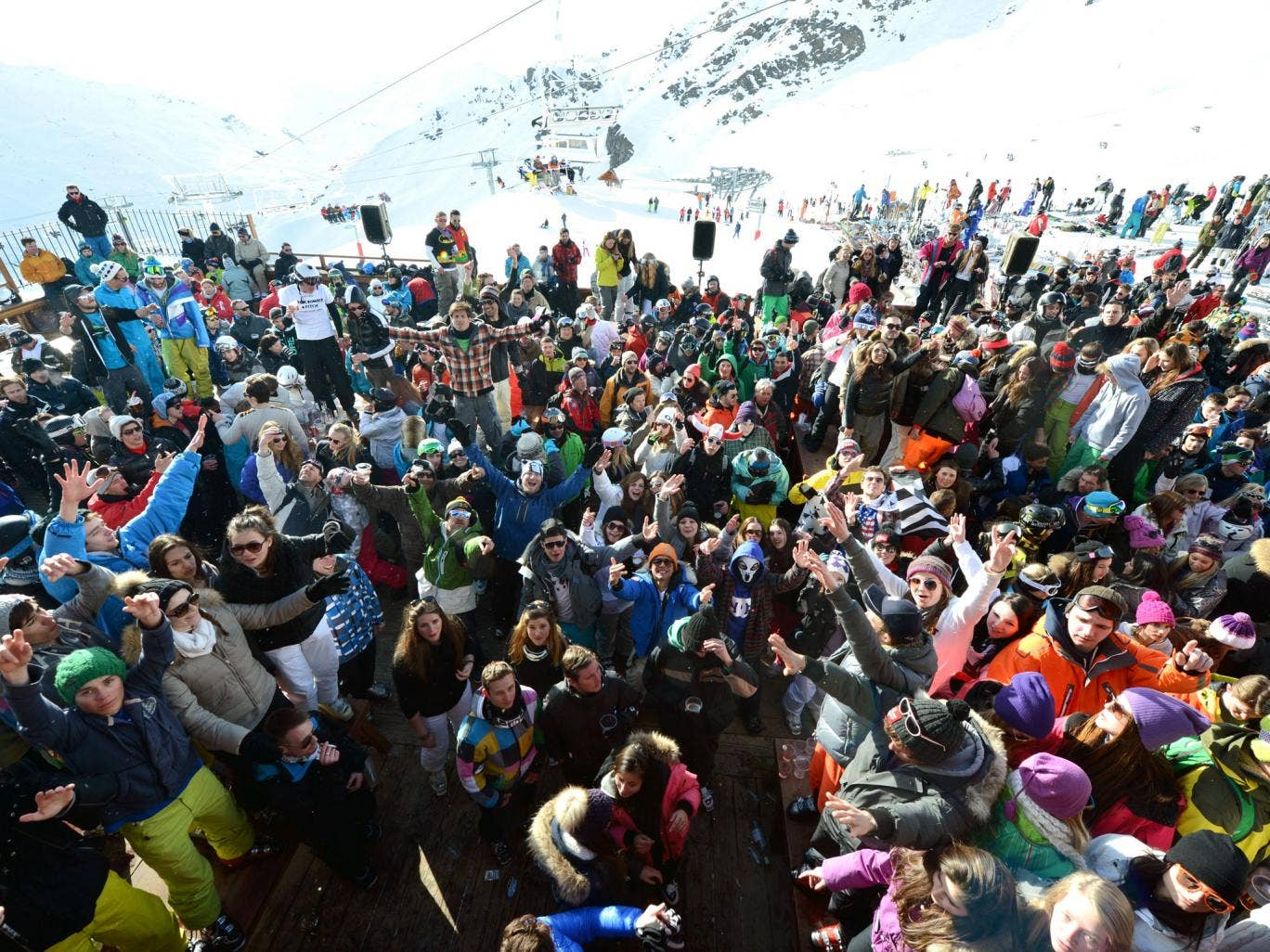 People drink and dance on an outdoor dance floor at the 'La Folie Douce' on February 28, 2013 in Val Thorens, French Alps. 'La Folie Douce' is an altitude fooding-clubbing concept held at the Val Thorens' restaurant 'La Fruitière' and the bar 'La Folie Do