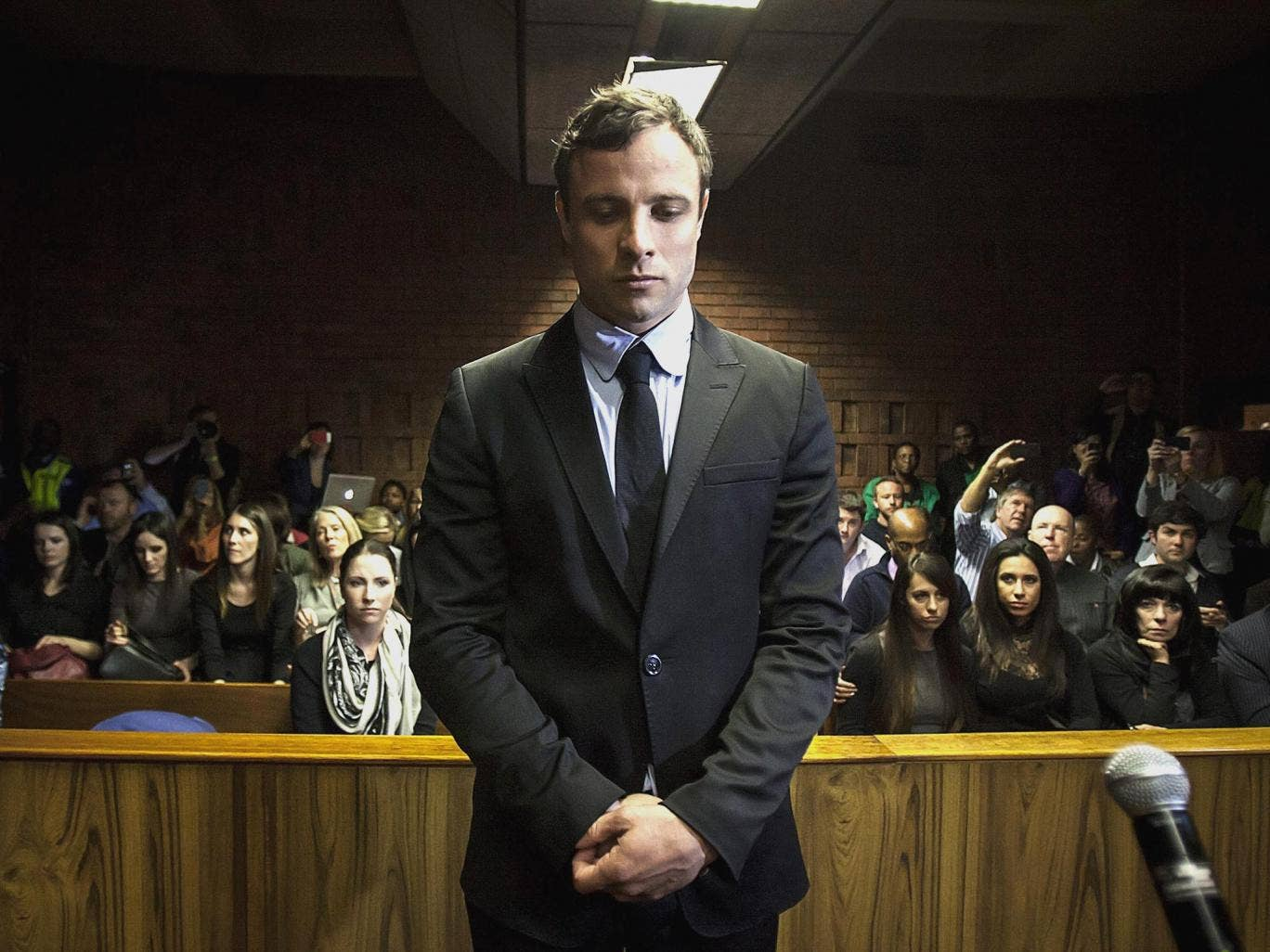 The accused: Oscar Pistorius appears at Pretoria magistrates' court at a preliminary hearing in August 2013