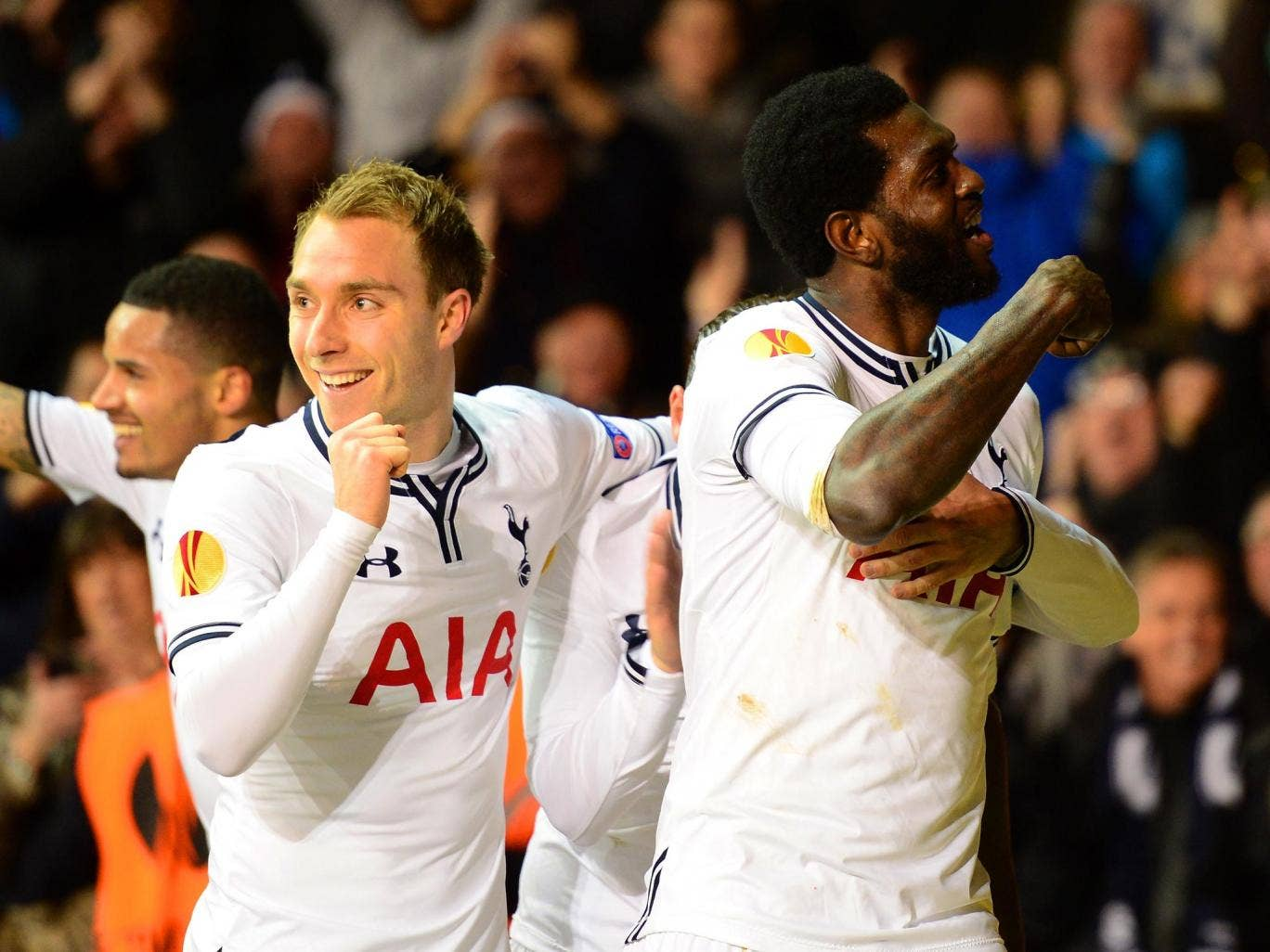 Emmanuel Adebayor of Tottenham Hotspur celebrates with team mate Christian Eriksen after scoring a goal