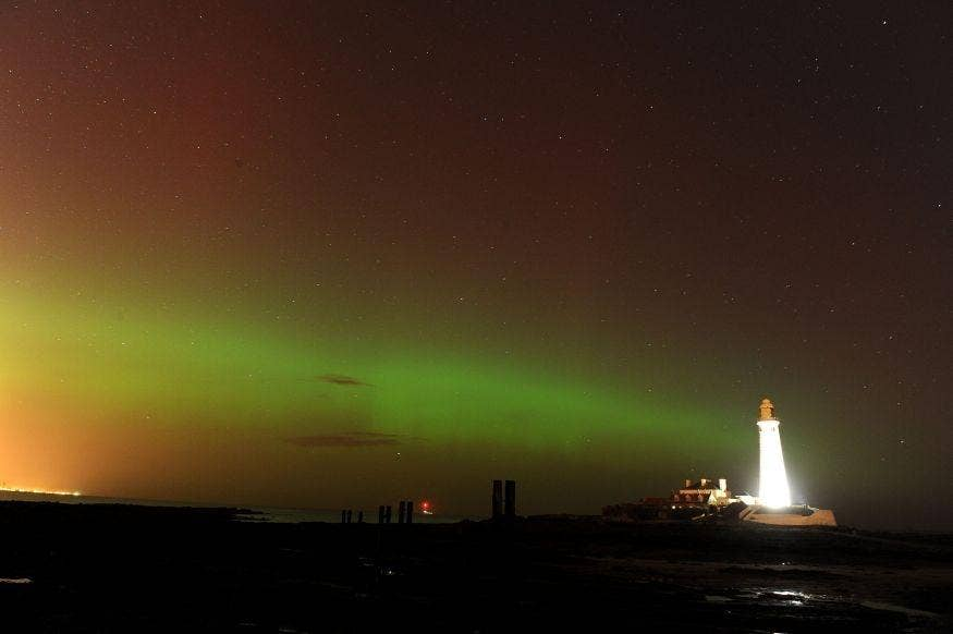 The aurora borealis, or the northern lights as they are commonly known, at St. Mary's Lighthouse and Visitor Centre, Whitley Bay, North Tyneside. PRESS ASSOCIATION Photo. Picture date: Thursday February 27, 2014.