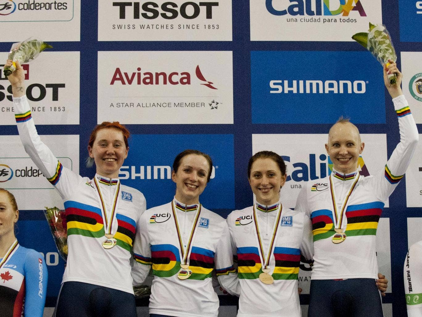Great Britain team Katie Archibald (2-L), Elinor Barker (1-L), Laura Trott (1-R) and Joanna Rowsell pose on the winners podium after winning gold medals in the Women's Team Persuit Final